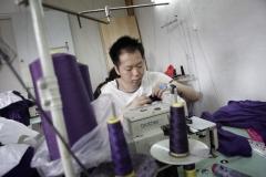 © Stephan NORSIC, France, La Courneuve, le 09/06/10. ATELIERS CHINOIS CLANDESTINS DE COUTURE : atelier de couture de M. Yang à la Courneuve.